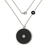 Pave set brilliant cut diamond and jet disc pendant