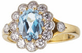 Aquamarine and diamond cluster engagement ring
