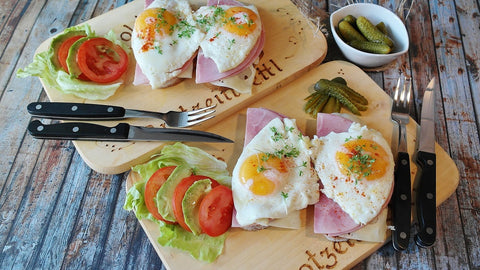 Eggs and toast on small chopping boards