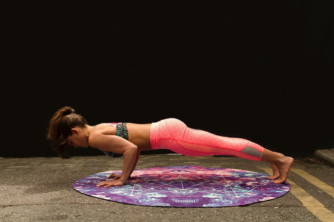 Woman on a yoga mat doing push ups