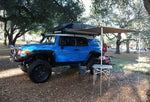 Camping Roll Out Awning Mounted On Jeep - Compact Camping Trailers