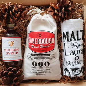The Cheers to The Holidays Box includes a wonderful array gourmet goods that are sure to delight family, friends, clients and more! Delicious Apple Fritter Brew Bread Mix, scrumptious mulling syrup, and a fun lovely Beer Teal Towel. We purchase from small shops throughout the USA. Because it's true, when you buy from a small business, an actual person does a little happy dance!  Gift someone to this lovely gift box or treat yourself!