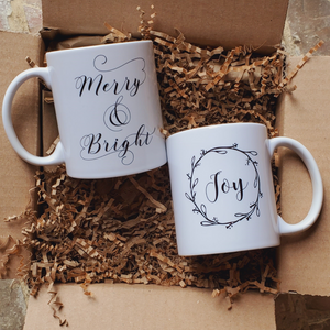 The Holiday Cheer Mug Bundle is filled with a Joy and Merry & Bright mug by Dallas-based The Weekender Shoppe. This gift set is a wonderful addition for the holidays! Perfect for your favorite beverage. From hot cocoa, coffee, to other delicious winter drinks!