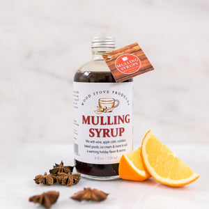 The Mulling Syrup by Wood Stove Kitchen is essentially the holiday season in a bottle. It contains cinnamon, cloves, allspice, orange zest, and Cape Cod cranberries. This syrup is intended for mixing with wine to make a wonderful mulled wine -- or with apple cider for a classic cold-weather beverage. This product will drive sales of wine, apple cider, cinnamon sticks, and other garnishes.