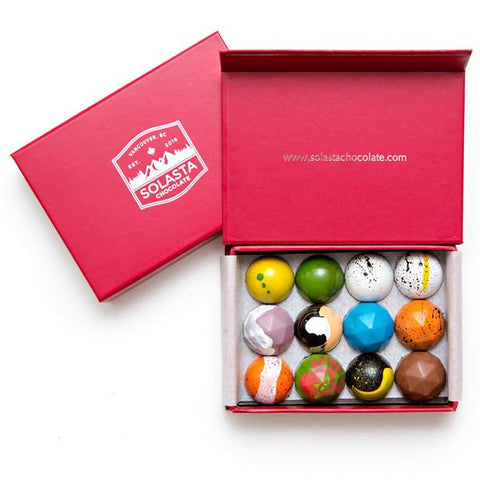 Box of brightly colored hand painted chocolates