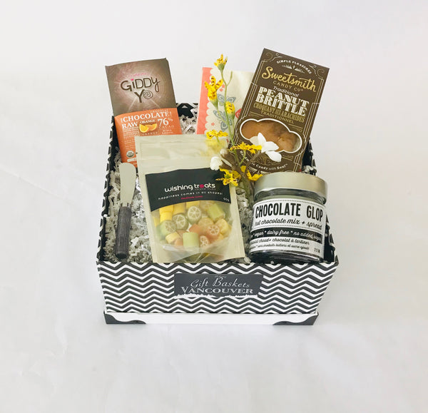 Black and white gift box with vegan chocolate and gourmet snacks