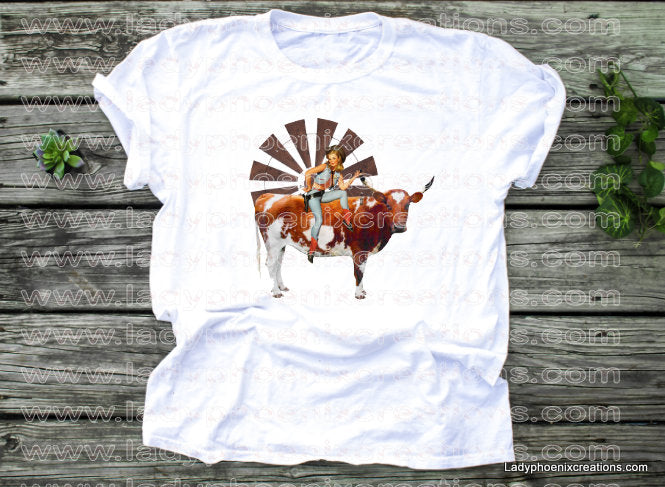 Pin up cowgirl on a steer windmill background Dye Sublimated shirts - Lady Phoenix Creations