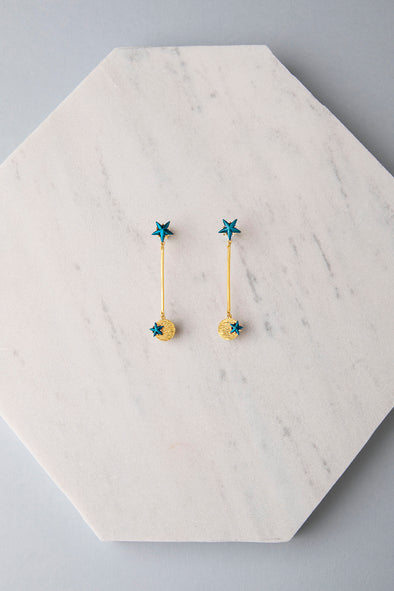 Star and small planet earrings blue