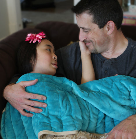 Child with CapeAble Weighted Blanket