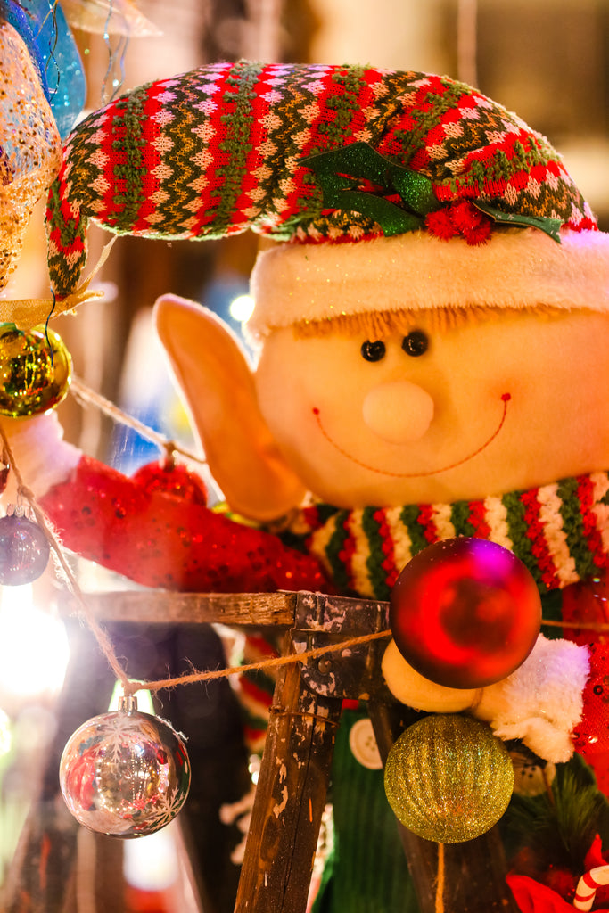 Magical Christmas Elf Decorates a Downtown Memphis Christmas Window Display