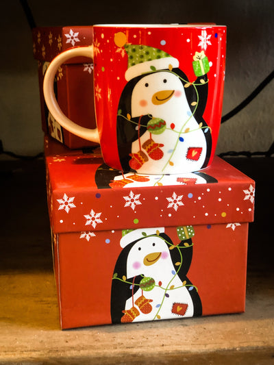Buy Penguins Christmas Holiday Coffee Mug from Walking Pants Curiosities, the Most un-General Gift Store in Downtown Memphis, Tennessee!