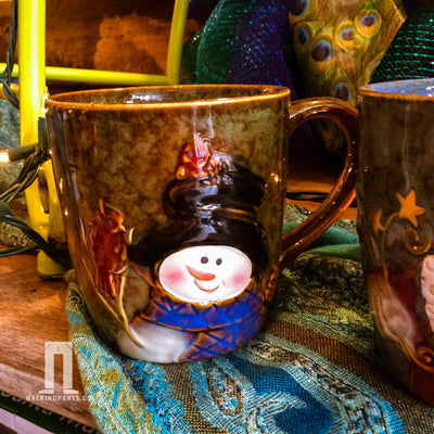 Buy Christmas Snowman Coffee Mug from Walking Pants Curiosities, the Most un-General Gift Store in Downtown Memphis, Tennessee!