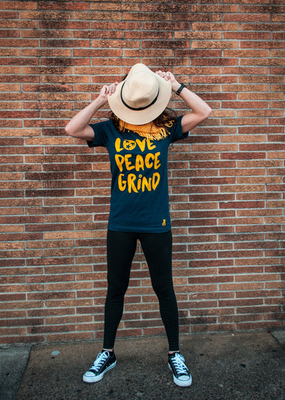 Buy Love, Peace, Grind Hippie Pants T-Shirt from Walking Pants Curiosities, the Most un-General Gift Store in Downtown Memphis, Tennessee!