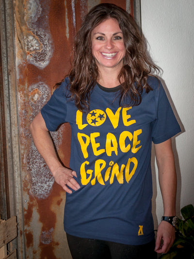 Buy Love, Peace, Grind Hippie Pants T-Shirt, a Shirts from Walking Pants Curiosities, the Best Gift Shop in Memphis, Tennessee!