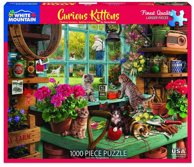 Buy Curious Kitten 1000 Piece Jigsaw Puzzle from Walking Pants Curiosities, the Most un-General Gift Store in Downtown Memphis, Tennessee!