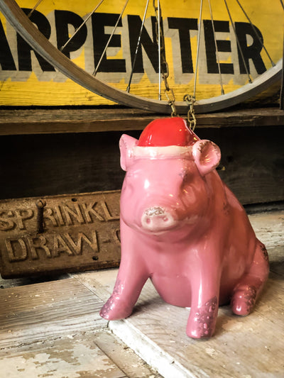 Buy Ceramic Santa Hat Pig Decor from Walking Pants Curiosities, the Most un-General Gift Store in Downtown Memphis, Tennessee!