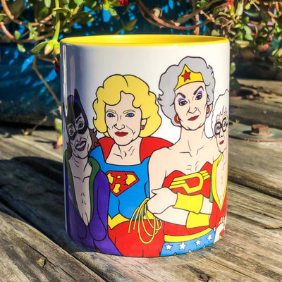Buy Golden Girls Turn Super Heroes Coffee Mug from Walking Pants Curiosities, the Most un-General Gift Store in Downtown Memphis, Tennessee!