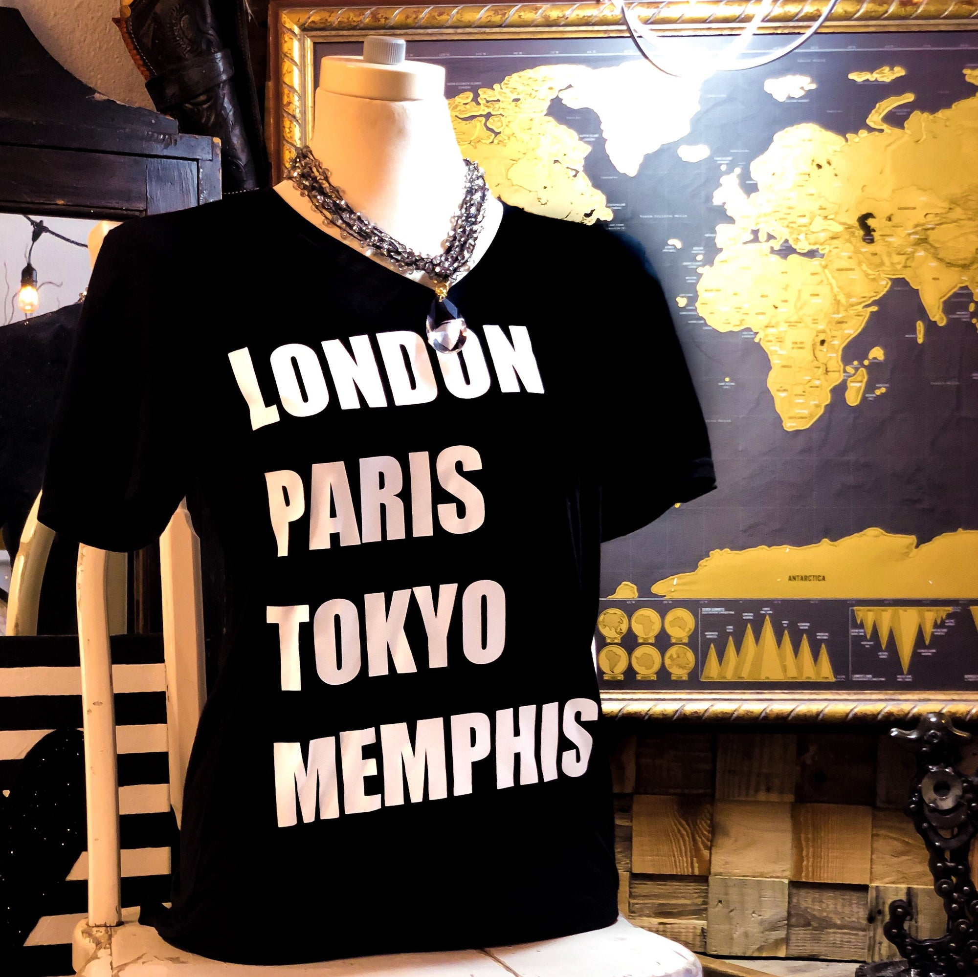 Buy The London Paris Tokyo Memphis V-Neck T-Shirt from Walking Pants Curiosities, the Most un-General Gift Store in Downtown Memphis, Tennessee!