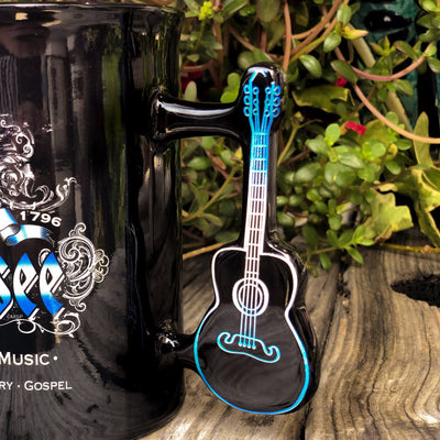 Buy Tennessee, Home of American Music, Coffee Mug with Guitar Handle from Walking Pants Curiosities, the Most un-General Gift Store in Downtown Memphis, Tennessee!