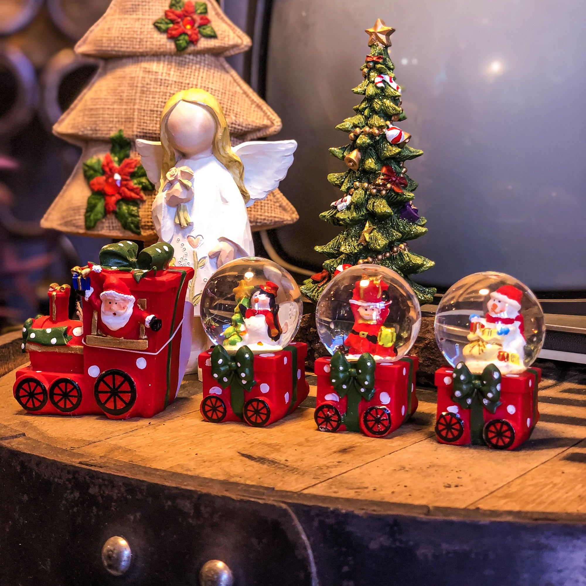 Buy Glass Snow Globe Train Set Of 4 from Walking Pants Curiosities, the Most un-General Gift Store in Downtown Memphis, Tennessee!