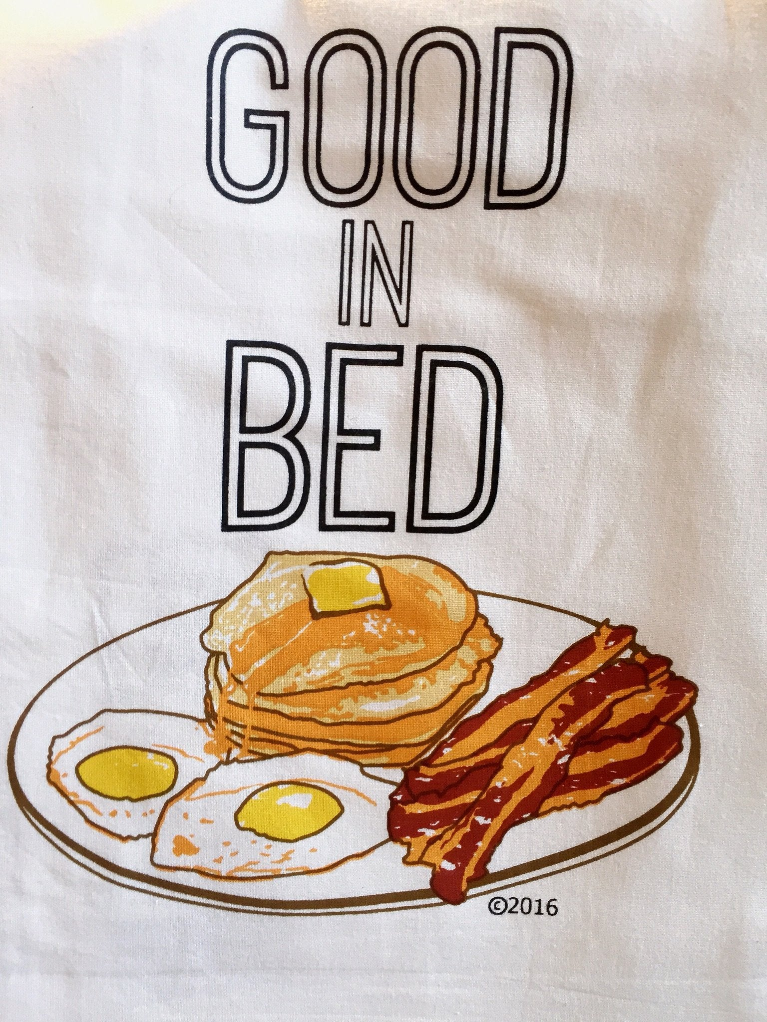 Buy Good In Bed Flour Sack Tea Towel from Walking Pants Curiosities, the Most un-General Gift Store in Downtown Memphis, Tennessee!
