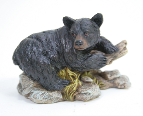 Buy Bear Laying On A Stump Figurine from Walking Pants Curiosities, the Most un-General Gift Store in Downtown Memphis, Tennessee!
