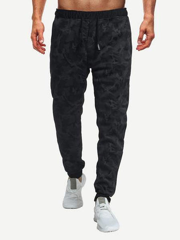 Front of SHEIN dark camo sweatpants with white sneakers