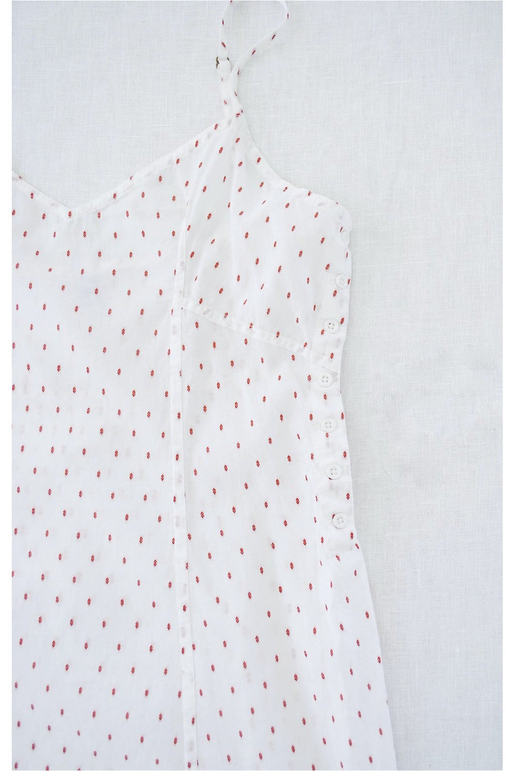 slip with side buttons in swiss dot print