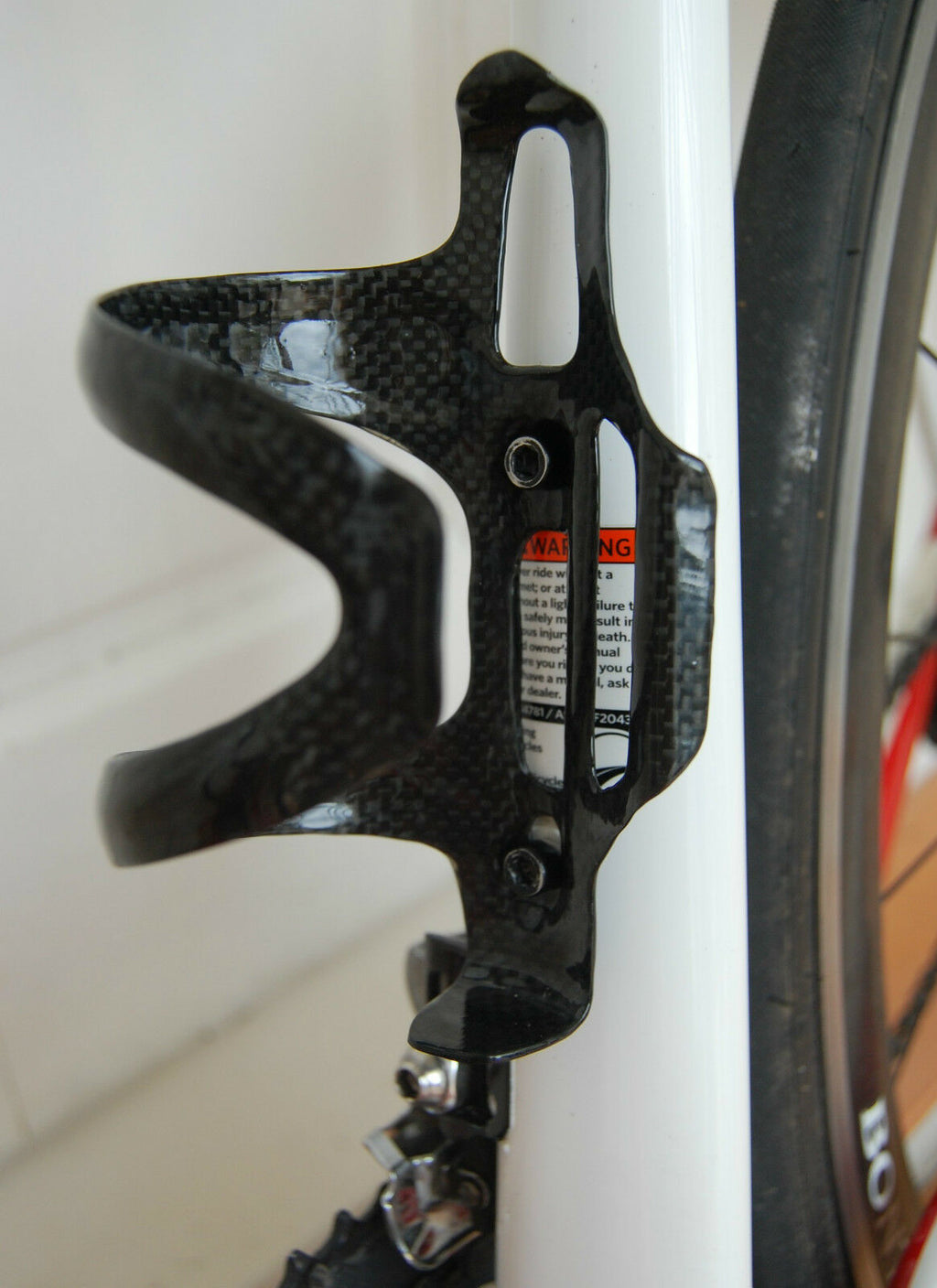 Side entry carbon cage