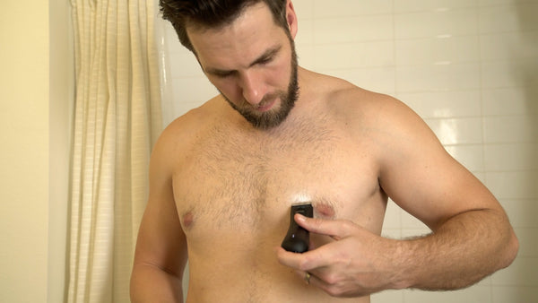 man shaving chest with lawn mower 3.0
