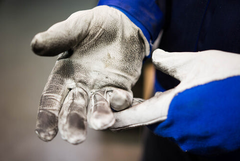 Hands Wearing Blue And White Gloves