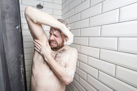 Man Holding His Armpit In The Shower