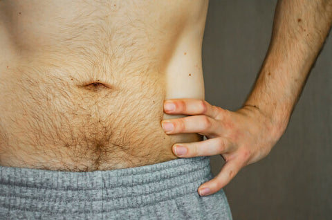 Man In Grey Shorts With A Hairy Stomach
