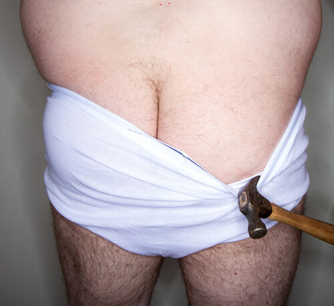 Man Pulling Down Underware With Hammer Showing Hairy Butt Crack