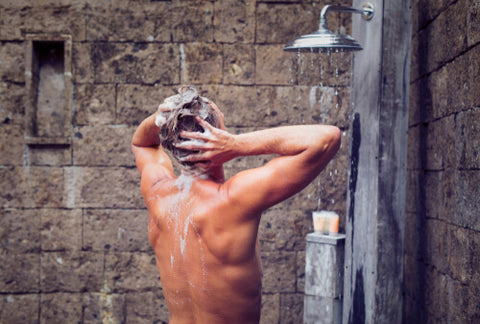 Man Showering With His Back To The Camera