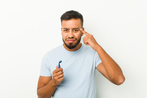 Man Thinking WIth A Razor In His Hand