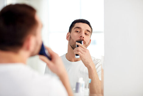 Man Trimming His Mustache
