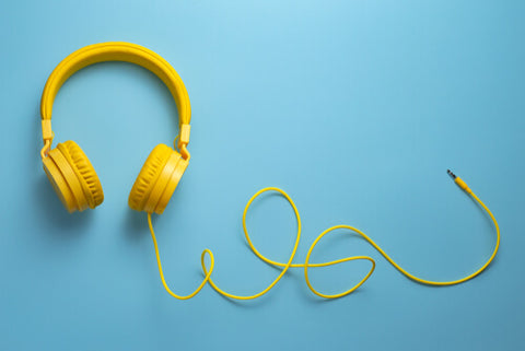 A Pair Of Yellow Headphones On A Cord