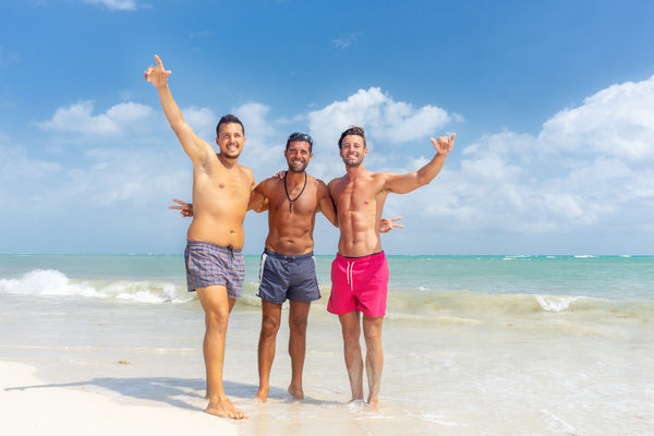 three men at the beach