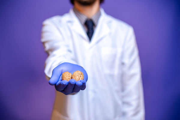 Doctor Holding Nuts
