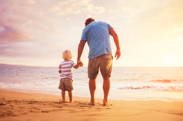 dad on beach with son