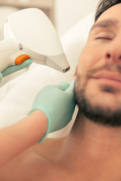 Man Getting Laser Ear Hair Removal