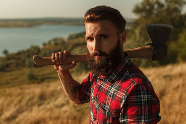 Bearded Man Holding An Axe