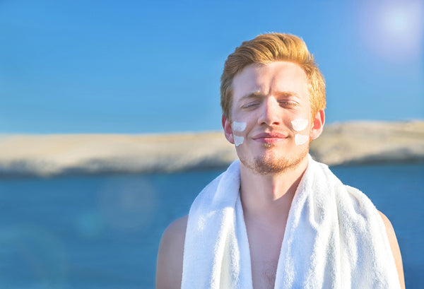 Man With Sunscreen On His Face At The Beach