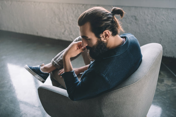 Man With A Man Bun On A Chair