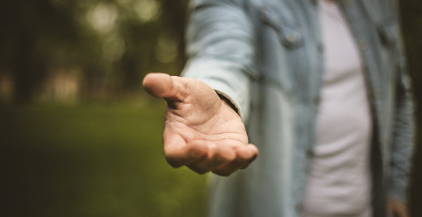 Man Holding His Hand Out