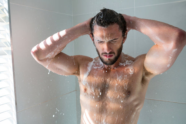 shirtless man in the shower