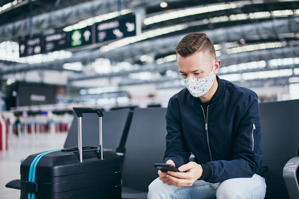 man with mask in airport