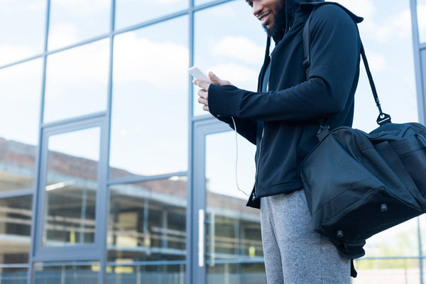 man with duffle bag