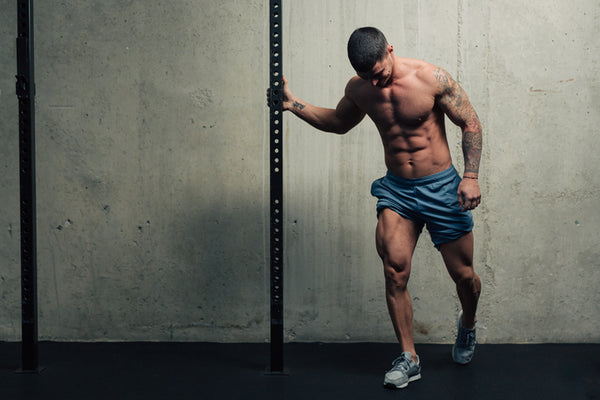 Man Strengthening His Legs At The Gym